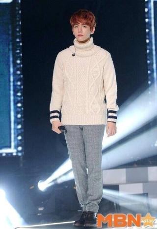 Baekhyun in a turtleneck sweater