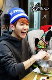 Baekhyun laughing and making rice balls