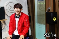 Chen Laughing by the door