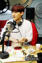 Chen listening and making food