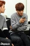 Chen reading his messages, Baekhyun looking at him
