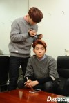 Chen taking a close up of Baekhyun's hair