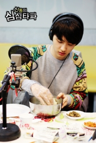 D.O. preparing rice balls