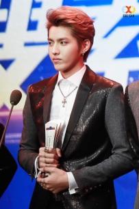 Kris holds the award