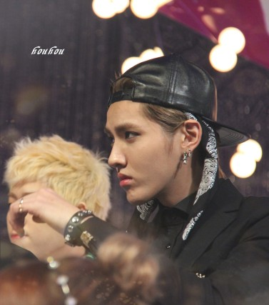 Kris in a black suit and cap