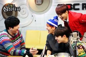 Shindong & BaekSooChen Laughing at Pics