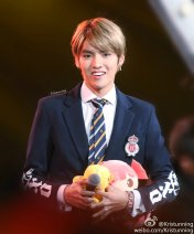 Kris and a stuffed duckling and doll