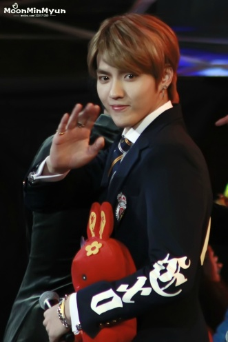 Kris with a red stuff-bunny says hi