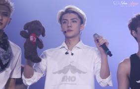 Sehun in a EXO SMTOWN WEEK logo shirt