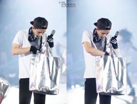 Sehun looking into his gift bag