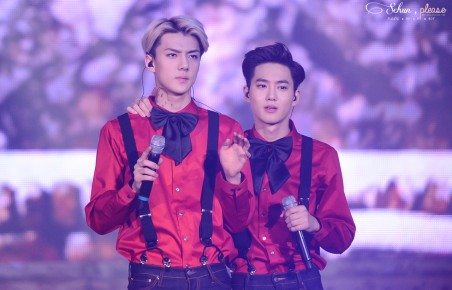Sehun & Suho in a red shirt with a bow tie and suspenders