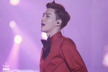 Suho in red shirt and black bow tie