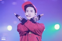 Suho in red sweater and cap