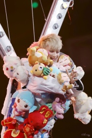 Tao in a outfit filled with many stuff-teddybears