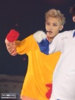 Tao in a very bright yellow shirt with red gloves