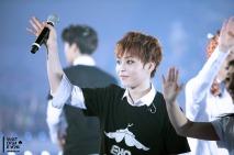 Xiumin in black and white EXO SMTOWN WEEK logo shirt